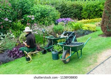 The female gardener, garden keeper in work at London park