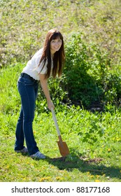 Female gardener planting tree outdoor in spring