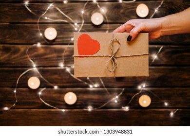 Female gives a gift card Valentine's day. Romantic mood concepts ideas.