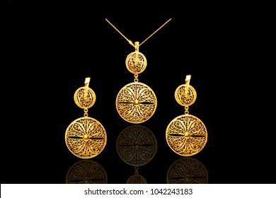 female Golden Eastern Turkish vintage women's handmade jewelry on a black background.earrings, pendants
