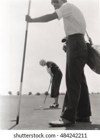 Female golfer and her caddy