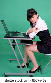 Female graphic designer with laptop and tablet pen.
