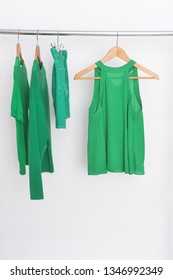 female green clothes with sweater ,shirt ,skirt on hanger