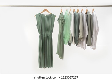female and green jacket ,suit and striped shirt blouse ,green dress ,coat isolated and on hanger