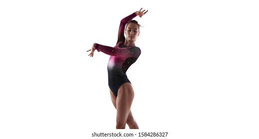 Female gymnast isolated on white.