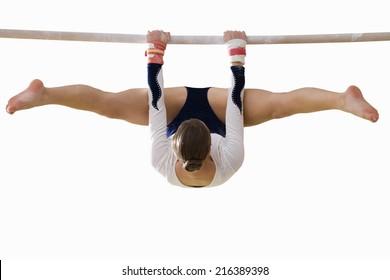 Female gymnast performing on bar, cut out