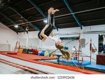 Female gymnast practicing a gymnastic