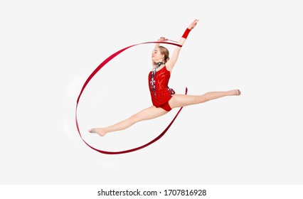 Female gymnast with red string leaping in air, isolated on white
