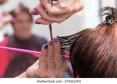 Female hair cutting scissors in a beauty salon