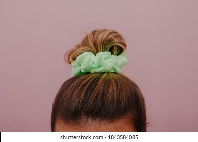 Female hair tied with scrunchie