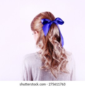 Female hairstyle with color ribbon isolated on white