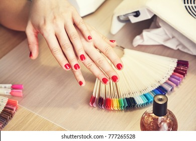 Female hand and accessories and tools for hardware manicure and receiving nail procedure