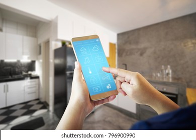 Female hand is adjusting lighting with smart phone. Smart home control concept.