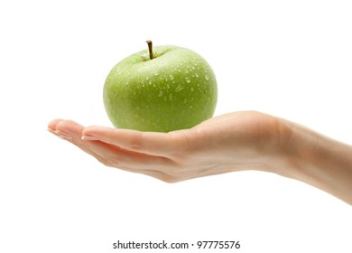 Female hand with an apple