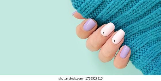 female hand beautiful stylish manicure sweater