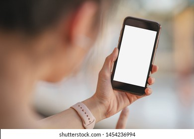 Female hand and blank screen mobile smart phone