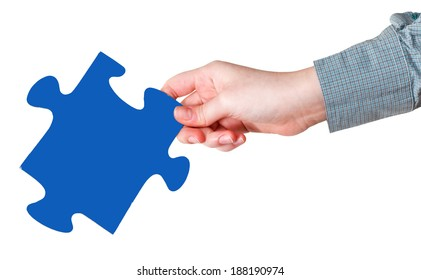female hand with blue puzzle piece isolated on white background
