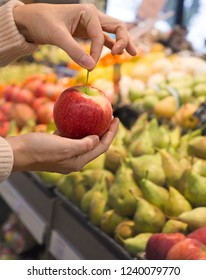 Female hand choosing fruits in the store