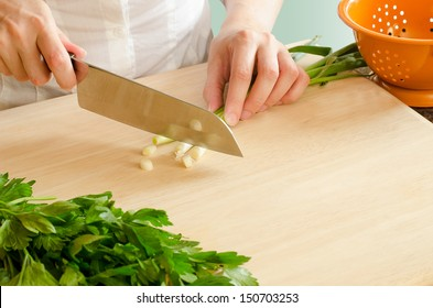 Female Hand Chopping Green Onions