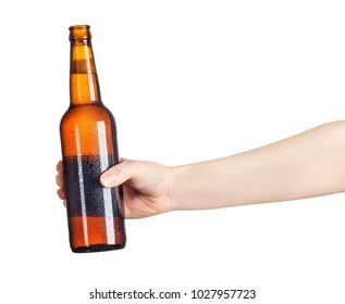 female hand with cold beer brown bottle isolated on white background