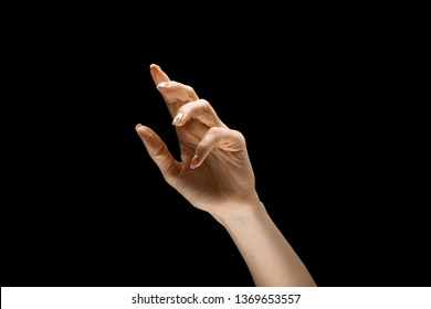 Female hand demonstrating a gesture of getting touch isolated on black studio background. Concept of human emotions, feelings, phycology or business.