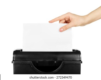 Female hand destroying sheet of paper with shredder isolated on white