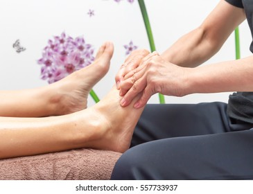 Female hand doing foot massage