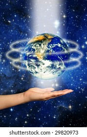 female hand with earth planet above it, surrounded by lights, against a space background