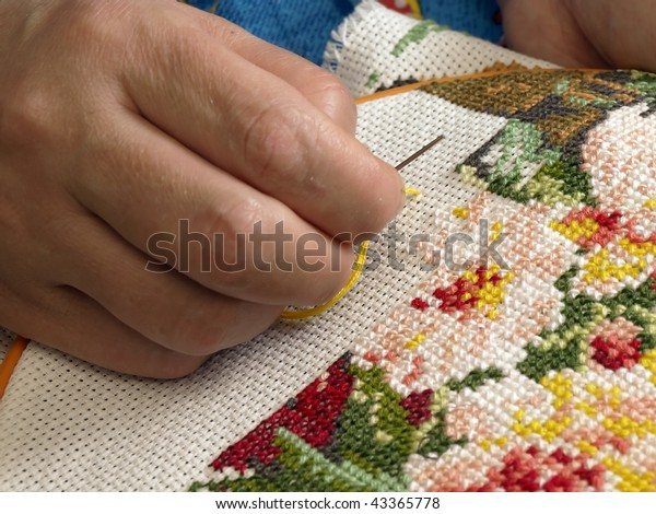 female-hand-embroider-cross-600w-4336577