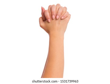 Female hand with fingers folded into fists, isolated on white background. Beautiful hand of woman with copy space, winning gesture.