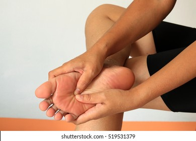 female hand with foot pain