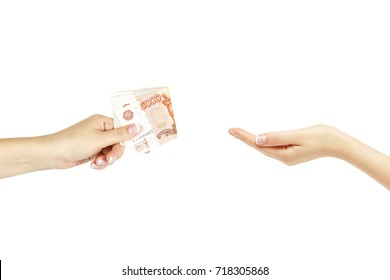 Female hand gives bunch of money another hand on white isolated background.