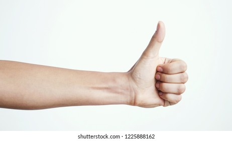 Female hand giving thumbs up on a white background. Thumb up hand sign isolated