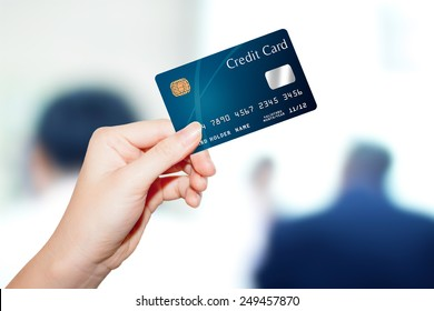 female  hand hold credit card