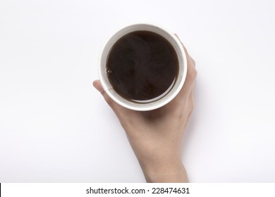 female hand hold a take out coffee cup with americano isolated white and top view.
