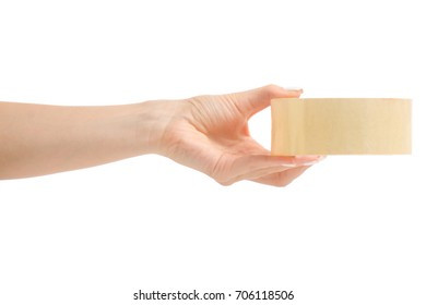 A female hand holding an adhesive tape on a white background isolated