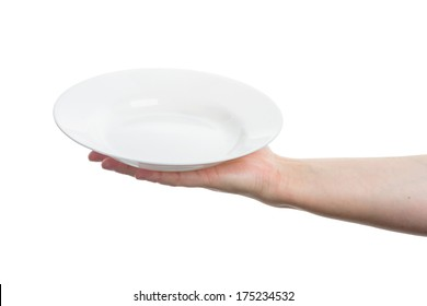 Female hand holding big white plate isolated on white background