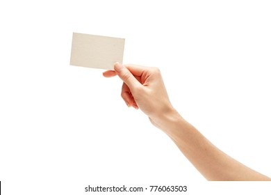 female hand holding blank business card isolated