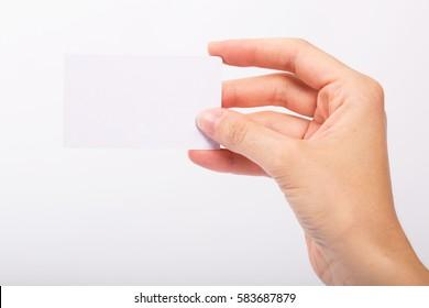 Female hand holding blank card isolated on white background