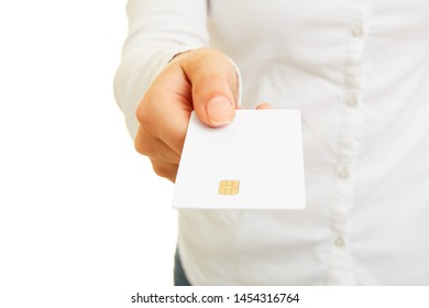 Female hand is holding a blank smart card or smartcard with contact chip