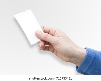A female hand holding an blank ticket - concept image with copy space