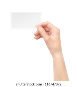 Female hand holding blank transparent business card in hand. Isolated on white.