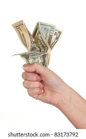 Female hand holding a bunch of dollar banknotes