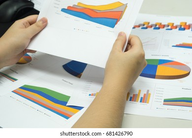 female hand holding business document statistic for analysis and planing for company ultimate goal for success. business analysis success concept.