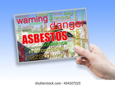 A female hand holding an card with asbestos theme