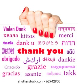 "Female hand holding card with the word ""thank you"" in many different languages"