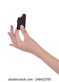 female hand holding chocolate biscuits isolated on white backgro