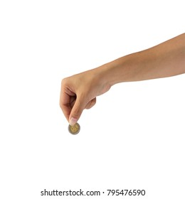 Female hand holding coin isolated on white background.
