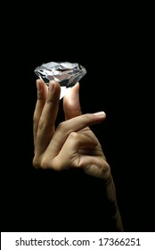 Female hand holding diamond