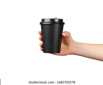 Female hand holding disposable coffee cup isolated on white background